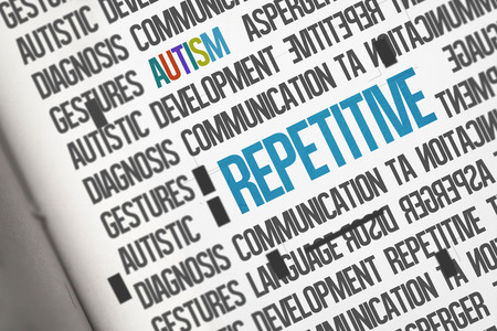 repetitive: The word repetitive against open book Stock Photo