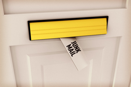 junk mail: The word junk mail against letter through post box