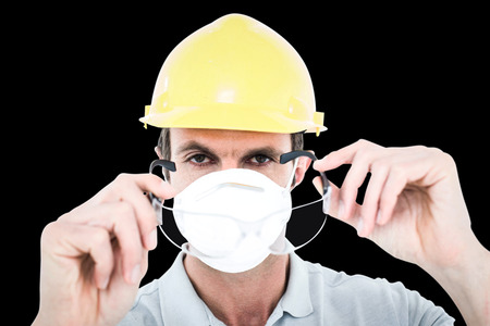 protective glasses: Worker wearing protective glasses over white background against black