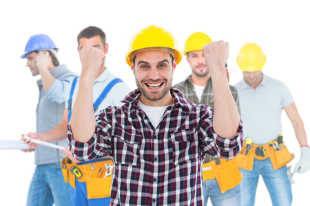 clenching: Composite image of successful male handyman clenching fists