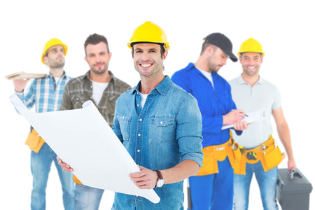 Composite image of happy architect holding blueprint in house photo
