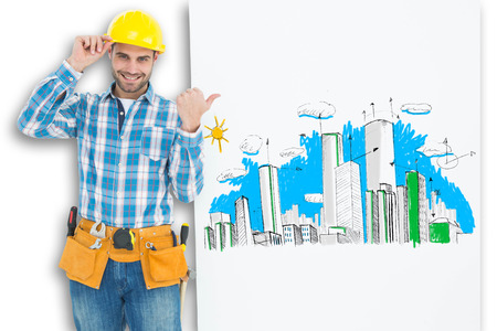 Happy repairman pointing towards blank billboard against crumpled white page