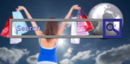lifting globe: Rear view of a brunette woman raising shopping bags against sky Stock Photo