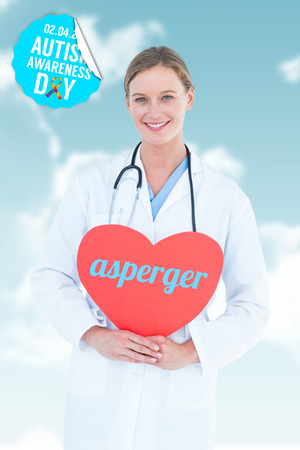 asperger: The word asperger and doctor holding red heart card  against blue sky