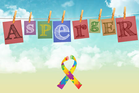 asperger: Autism awareness ribbon against digitally generated grey background Stock Photo