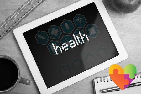 workplace wellness: The word health and autism awareness heart against medical interface in blue and white Stock Photo