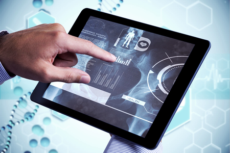 using tablet: Man using tablet pc  against medical icons in blue and white