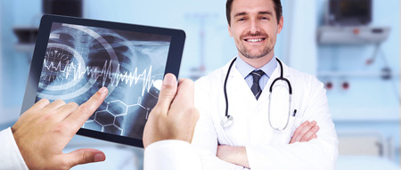 Man using tablet pc against sterile bedroom photo