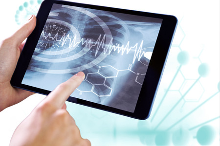 ribcage: Man using tablet pc against blue medical background with dna