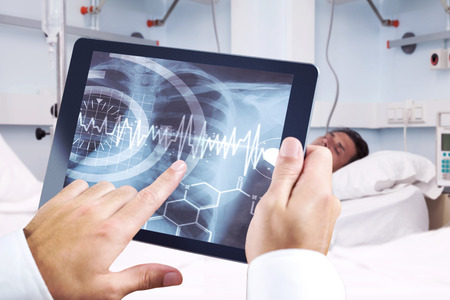 ribcage: Man using tablet pc against medical interface on xray