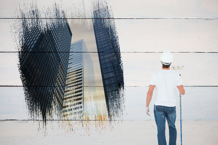 redecorating: Painter against low angle view of skyscrapers