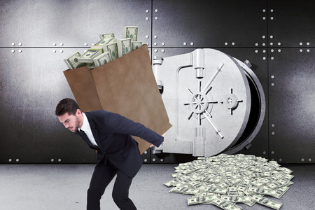 opened bag: Businessman carrying bag of dollars against digitally generated opened safe Stock Photo