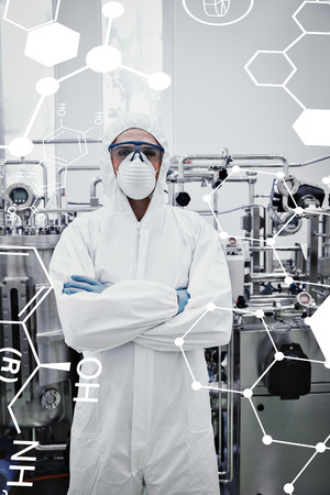 protective suit: Science formula against scientist in protective suit standing with arms crossed