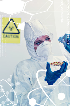 Science and medical graphic against scientist in protective suit with sprouts in laboratory photo