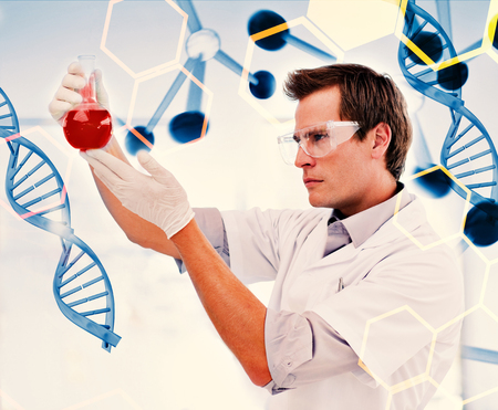 biologist: Science and medical graphic against biologist examining a beaker of blood Stock Photo
