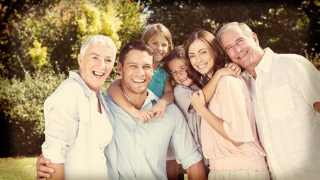 abuelos: Sonriendo familia y abuelos en el campo mirando a la cámara