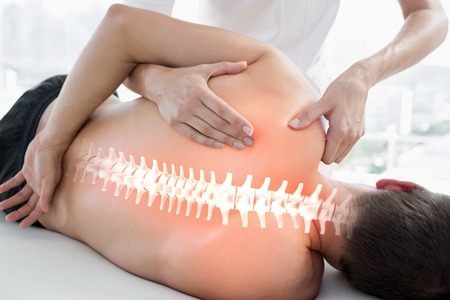 pain: Digital composite of Highlighted bones of man at physiotherapy Stock Photo