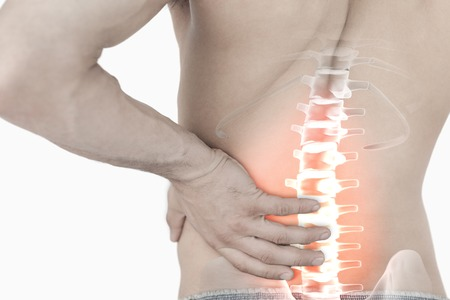 Digital composite of Highlighted spine pain of man photo