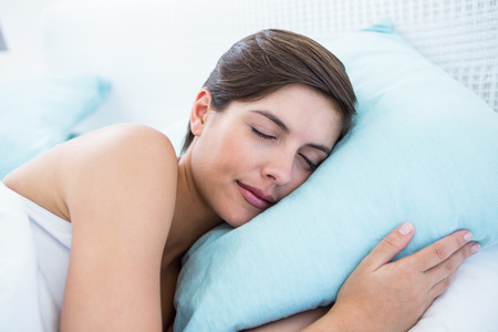 bedroom bed: Beautiful woman sleeping in her bed at home in the bedroom