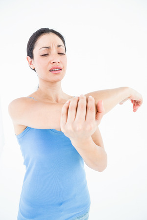 elbow pain: Pretty woman suffering from elbow pain on white background Stock Photo