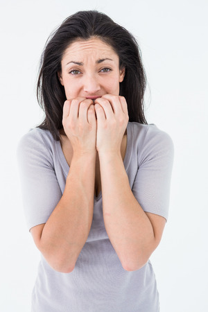 unhappiness: Depressed woman looking at camera on white background Stock Photo