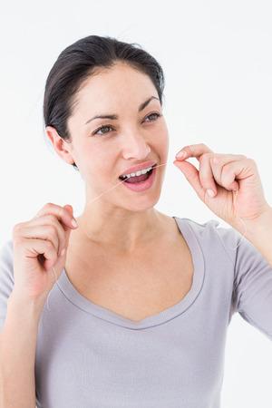 dental floss: Woman using dental floss on white background Stock Photo