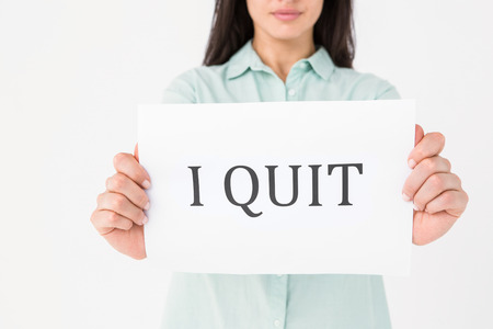 fag: Brunette holding i quit card on white background Stock Photo