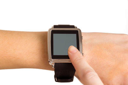 portable information device: Woman using her smart watch on white background Stock Photo