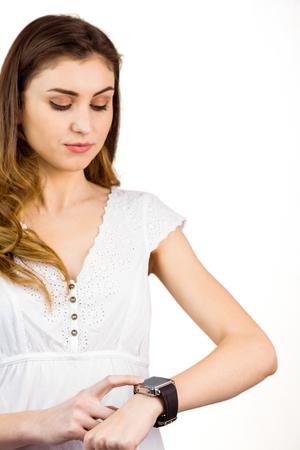 cut wrist: Pretty woman using her smart watch on white background