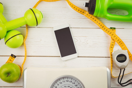 healthy: Smartphone with indicators of healthy lifestyle on wooden table Stock Photo