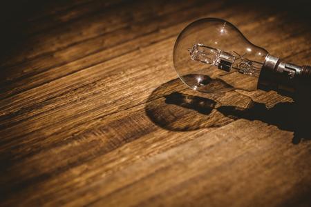Light bulb on wooden table