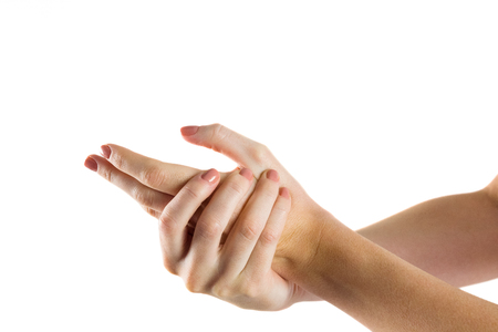 pain: Woman with hand injury on white background