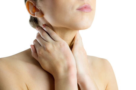 wincing: woman with a neck injury on white background