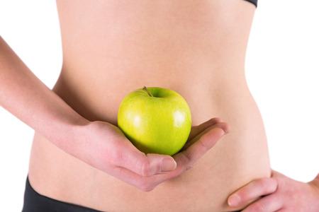 silhouette femme: Femme tenant la pomme verte sur fond blanc