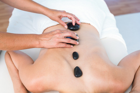 hot stone: Woman getting hot stone massage in a healthy spa