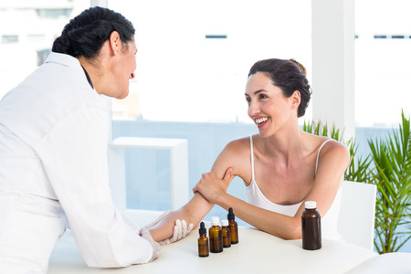 prick: Doctor doing skin prick test at her patient in medical office