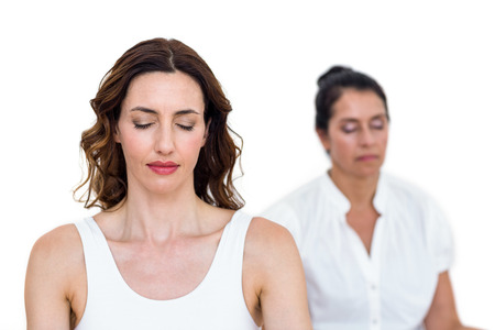 slender woman: Women sitting in lotus pose on white background Stock Photo