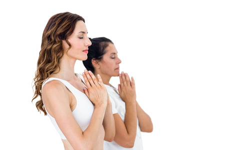 manos levantadas: Relajado mujer haciendo yoga en el fondo blanco Foto de archivo