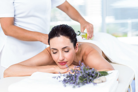 aromatherapy: Smiling woman getting an aromatherapy treatment in a healthy spa