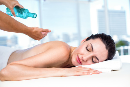 body care: Relaxed brunette receiving back massage in a healthy spa