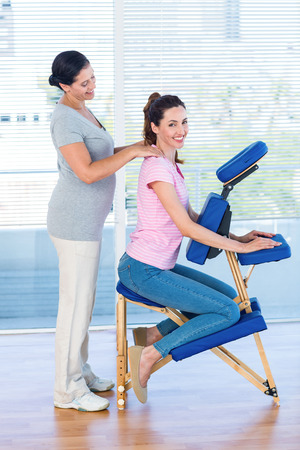 massage chair: Woman having back massage in medical office Stock Photo