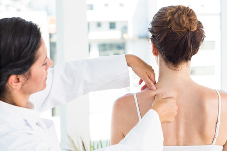 squeezing: Doctor squeezing her patients spot in medical office Stock Photo