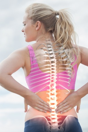 hair tied back: Digital composite of Highlighted spine of woman with back pain Stock Photo