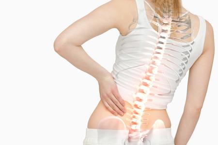 背中の痛みと女性の反転表示された背骨のデジタル合成 写真素材