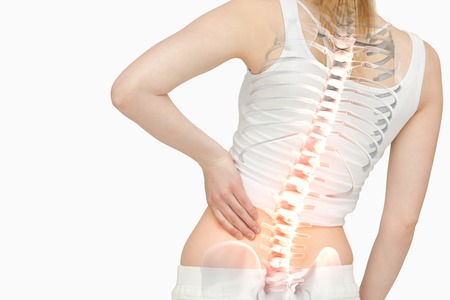 digital composite: Digital composite of Highlighted spine of woman with back pain Stock Photo