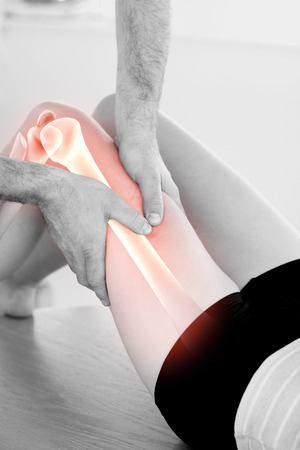 joint mobilization: Digital composite of Highlighted bones of woman at physiotherapist Stock Photo