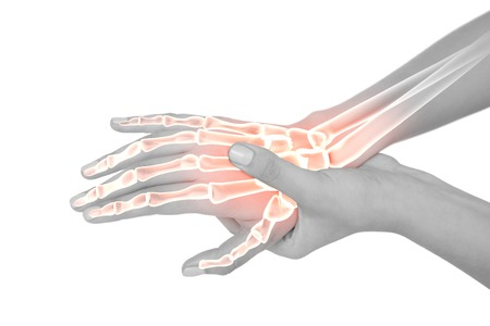 cut wrist: Digital composite of Highlighted bones of woman with hand pain