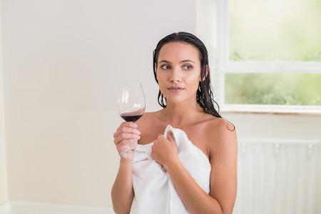 wetting: Pretty brunette drinking red wine in her bedroom