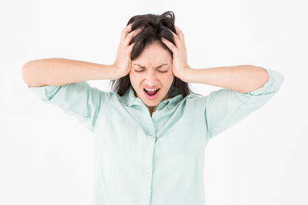 bleakness: Depressed woman shouting on white background Stock Photo