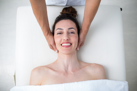 neck massage: Physiotherapist doing neck massage in medical office
